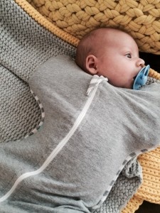 Hudson in his Love to Swaddle Up sleep suit