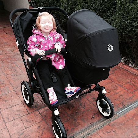 Ella loving life in 'her' double pram